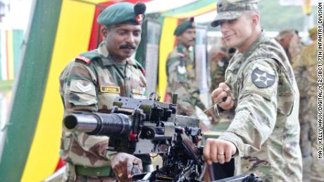 An Indian soldier showcases a grenade launcher to a US soldier on Sept. 15, 2016, at Chaubattia, India.