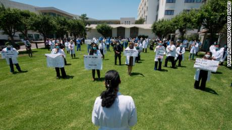 Doctors, nurses and other health care workers participate in a White Coats for Black Lives event in solidarity with George Floyd and other black Americans killed by police officers on June 11 at the Queen of the Valley Hospital in West Covina.
