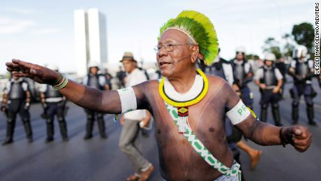 FILE PHOTO: Indigenous leader Paulinho Paiakan of Kayapo tribe, takes part a protest against Brazil's president Michel Temer for the violation of indigenous people's rights, in Brasilia, Brazil April 24, 2017. REUTERS/Ueslei Marcelino