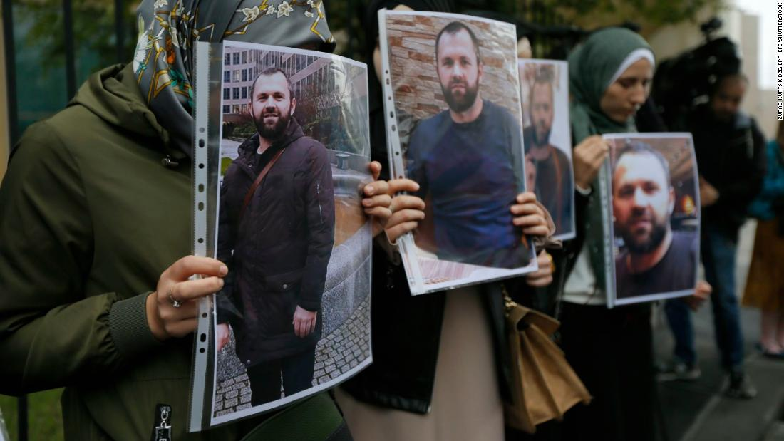 People hold portraits of Zelimkhan Khangoshvili in front of the German embassy in Tbilisi, Georgia on September 10, 2019