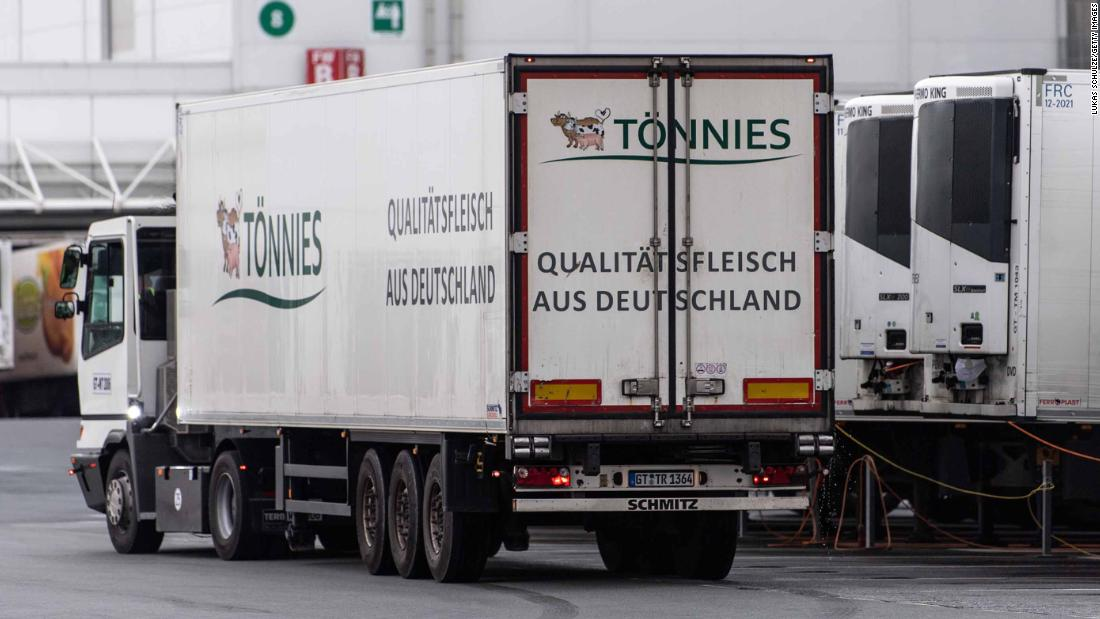 RHEDA-WIEDENBRUECK, GERMANY - JUNE 17: Trucks stand at the Toennies meat packing plant during the coronavirus pandemic in Rheda-Wiedenbrueck on June 17, 2020 near Guetersloh, Germany. Authorities announced today that schools and child day care centers in the region will be shut temporarily following a dramatic increase in the number of confirmed Covid-19 infections among workers at the Toennies plant. A total of 415 infected workers have been confirmed, with the number likely to rise as further test results become available. According to media reports 7,000 people are in quarantine. (Photo by Lukas Schulze/Getty Images)