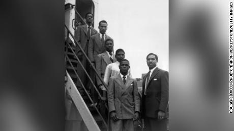 From the top, hopeful Jamaican boxers Charles Smith, Ten Ansel, Essi Reid, John Hazel, Boy Solas and manager Mortimer Martin arrive at Tilbury on the Empire Windrush.