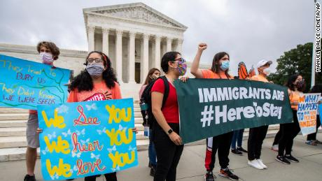 Deferred Action for Childhood Arrivals (DACA) students celebrate in front of the U.S. Supreme Court after the Supreme Court rejects President Donald Trump's bid to end legal protections for young immigrants, Thursday, June 18, 2020, in Washington.
