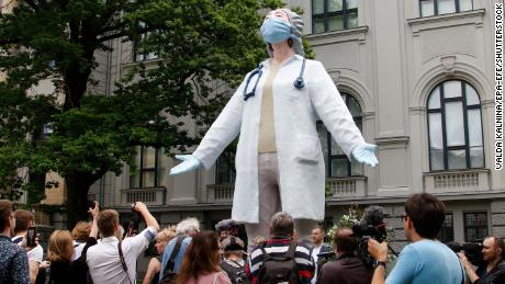 Latvian artist Aigars Bikše unveils a statue honoring the health care workers battling Covid-19.