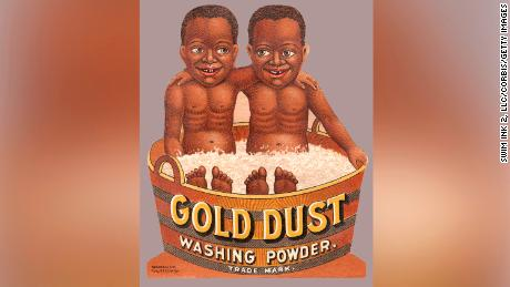 A Gold Dust Washing Powder trade card features the companies Gold Dust Twins mascots.