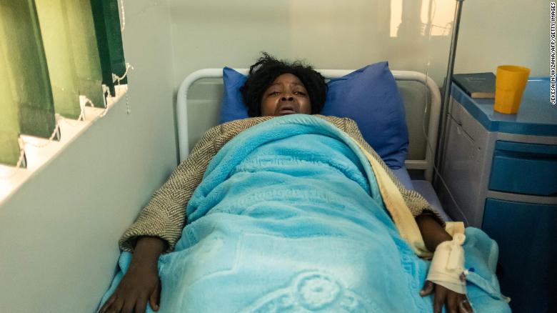 Cecilia Chimbiri lies on a hospital bed at a private hospital in Harare on May 15. She is one of the three youth leaders from the MDC Alliance who were admitted after allegedly being abducted and beaten up by police.