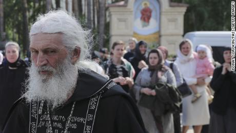Father Sergii walks at the Sredneuralsky Convent.