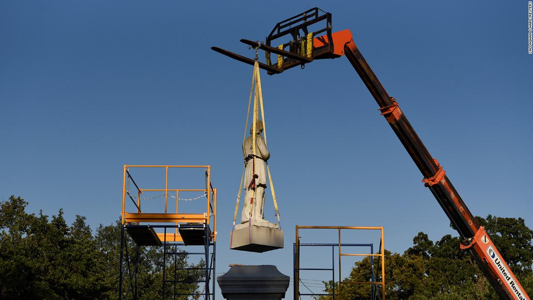 A statue of Confederate Commander Richard W. Dowling is removed in Houston, Texas, on June 17, 2020.