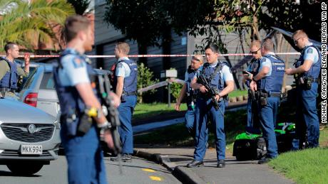 Armed police gather at the scene of a deadly shooting incident following a routine traffic stop in Auckland, New Zealand, on Friday.