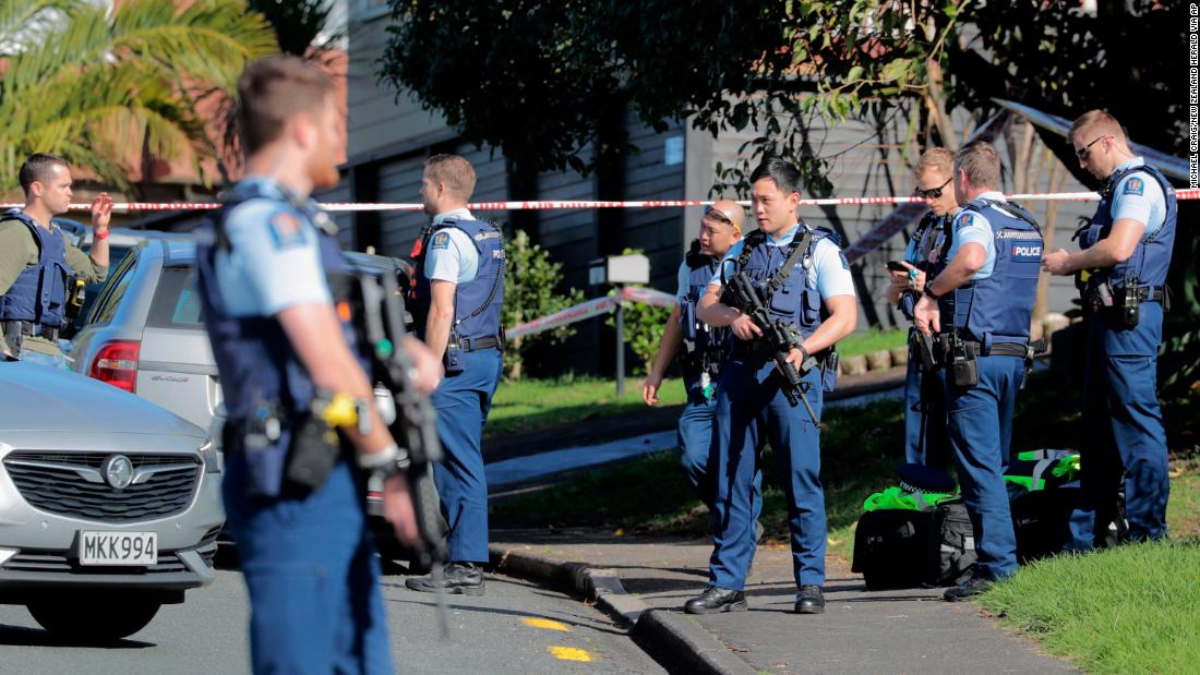 Armed police gather at the scene of a shooting incident following a routine traffic stop in Auckland, New Zealand, Friday, June 19, 2020.