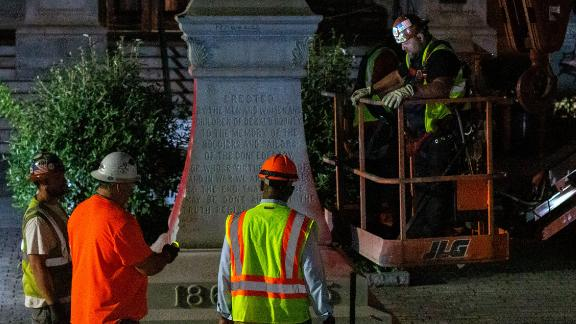 Workers remove a Confederate monument from Decatur square in Georgia on Friday, June 19.