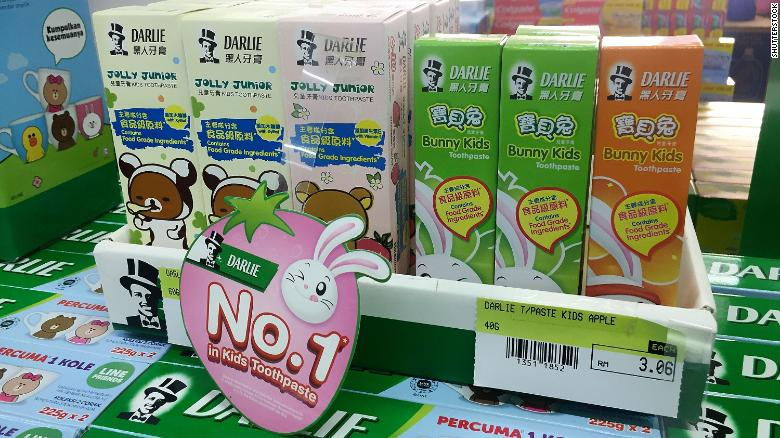 """Darlie kids' toothpaste in a shop in Malaysia, with Chinese characters marketing it as """"Black Person Toothpaste."""""""