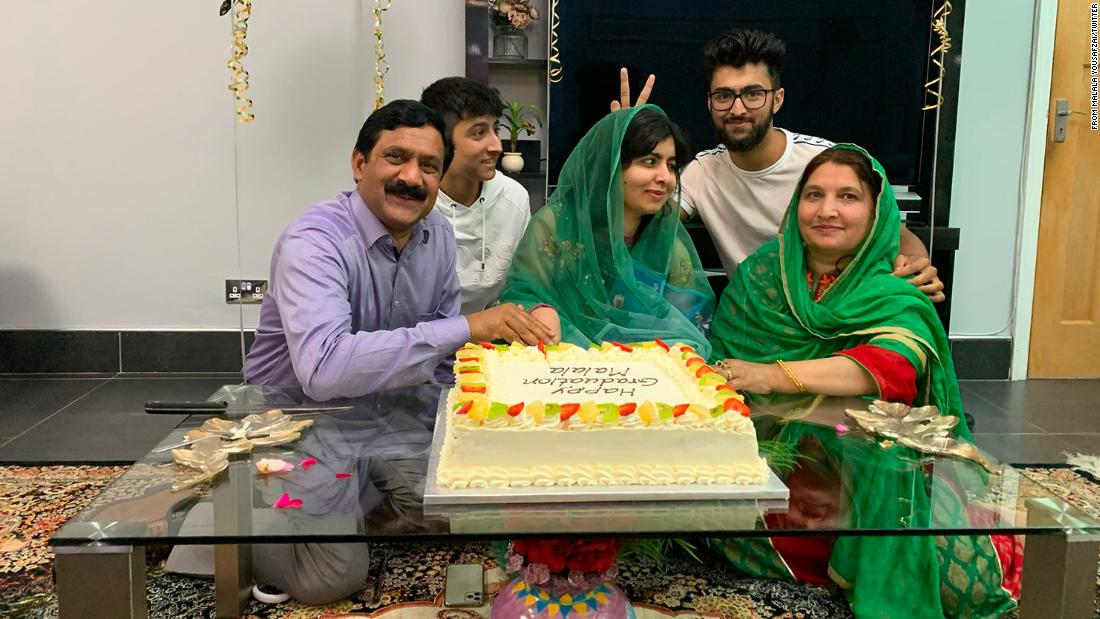 Malala Yousafzai, who survived a Taliban assassination attempt as a child in Pakistan before moving to England, celebrates completing university with her family.