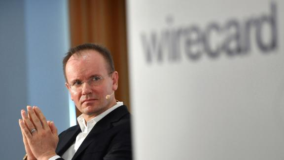 """Wirecard redistributes responsibilities internally and disempowers CEO Markus Braun. The payment service provider is reacting dawith to the growing criticism of the management. In the future, CEO Markus Braun should concentrate on the """"strategic development"""" of the group, he has to hand over the responsibility for capital market communication to CFO Alexander von Knoop. Archive photo; Dr. Markus BRAUN (CEO, Management Chairman), gesture, folds his hands in prayer. Single picture, cut single motif, portrait, portrait, portrait. In front - the wirecard logo and lettering. Annual press conference WIRECARD AG ' 