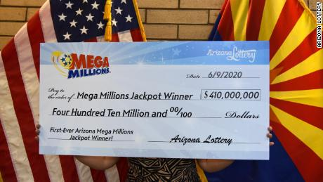 "One half of the Arizona couple who won a $410 million Mega Millions jackpot said her ""left hand had been itching for two weeks,"" which she said meant money was coming her way."