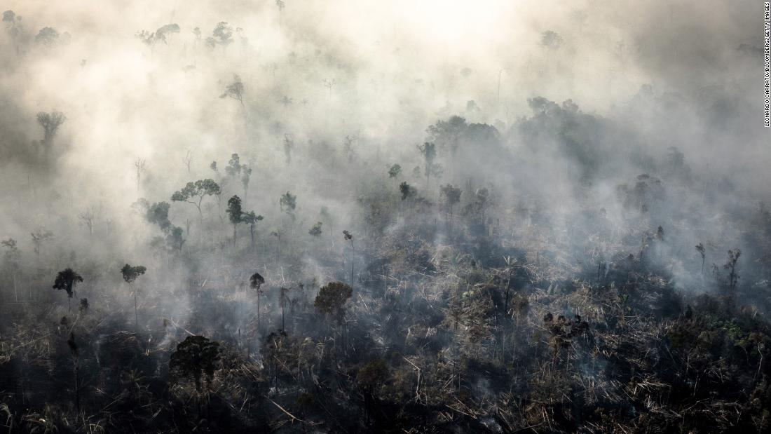 Bloomberg Best of the Year 2019: Smoke rises as a fires burn in the Amazon rainforest in this aerial photograph taken above the Candeias do Jamari region of Porto Velho, Rondonia state, Brazil, on Saturday, Aug. 24, 2019. Photographer: Leonardo Carrato/Bloomberg via Getty Images