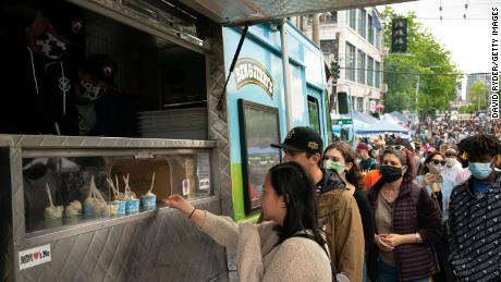 """People line up for samples of Ben & Jerry's ice cream during ongoing Black Lives Matter events in the so-called Capitol Hill Organized Protest"""" area on June 14, 2020 in Seattle."""
