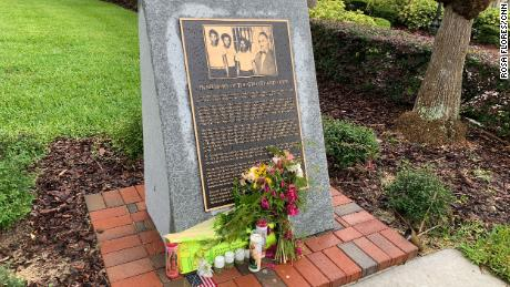 A tribute to  George Floyd rests on the memorial erected for the Groveland Four at the Old Lake County  Courthouse.