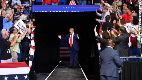 US President Donald Trump arrives for a campaign rally at the BOK Center on June 20, 2020 in Tulsa, Oklahoma. - Hundreds of supporters lined up early for Donald Trump's first political rally in months, saying the risk of contracting COVID-19 in a big, packed arena would not keep them from hearing the president's campaign message.