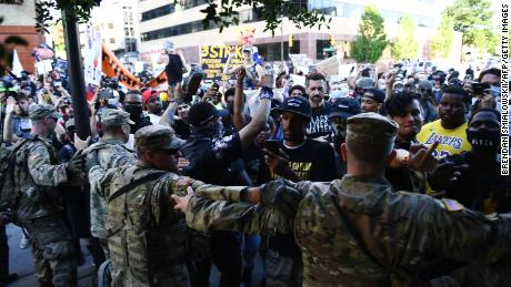 Members of the National Guard formed a barrier to stop protesters near the Bank of Oklahoma Center in Tulsa.