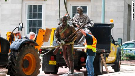 Crews in Raleigh remove a statue of Henry Lawson Wyatt, the first North Carolinian killed in battle in the Civil War.