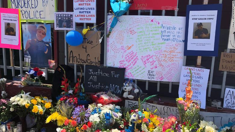A memorial has formed outside the body shop where Andres Guardado was shot and killed by a Los Angeles County Sheriff deputy on Thursday, June 18, 2020.