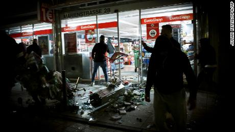 Hundreds of rioters in small groups looted stores and clashed with police in Stuttgart.