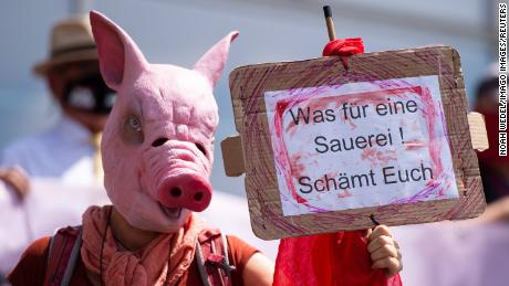 A demonstration at a news conference over the outbreak at Toennies meat processing plant in Guetersloh.