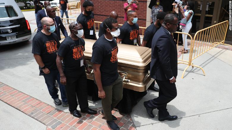 Pallbearers bring the remains of Rayshard Brooks into the Ebenezer Baptist Church for his viewing.