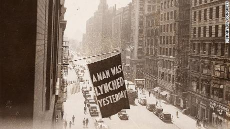 A flag announcing a lynching is flown from the window of NAACP headquarters in 1936 in New York City.