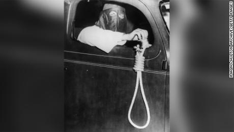 A member of the Ku Klux Klan holds a noose out a car window during a demonstration in 1939 in Miami.