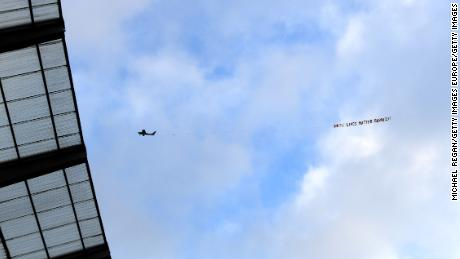 "A plane flies over the Etihad Stadium with a banner reading ""White Lives Matter Burnley."""