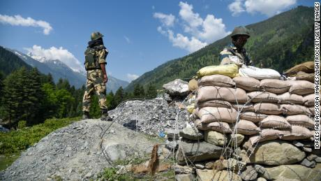 GANDERBAL, INDIA - 2020/06/18: Member of Border security force keeps vigil inside a bunker next to National Highway leading to Ladakh. India and China held talks again on 18 June to cool down the situation in the area where violent clashes between Indian and Chinese soldiers took place on Monday night. 20 Indian soldiers including a Colonel were killed in violent clashes with Chinese soldiers in Galwan Valley disputed border area. (Photo by Idrees Abbas/SOPA Images/LightRocket via Getty Images),India and China held talks again on 18 June 2020 to cool down situation in the area where violent clashes between Indian and Chinese soldiers took place on Monday night. 20 Indian soldiers including a Colonel were killed in violent clashes with Chinese soldiers in Galwan Valley disputed border area.