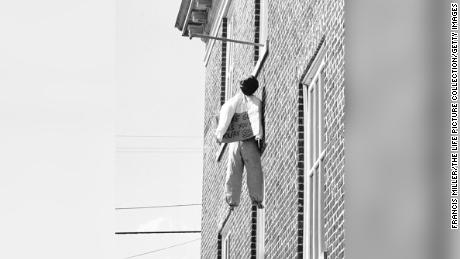 A doll hangs from a noose outside a dorm window on the campus of Mississippi State University in 1962 -- an apparent protest against James Meredith, the first African American student admitted to the segregated University of Mississippi.