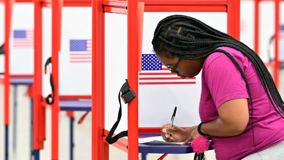 A voter fills out her ballot during the Kentucky Primary at the Kentucky Exposition Center in Louisville, Ky., Tuesday, June 23, 2020. (AP Photo/Timothy D. Easley)