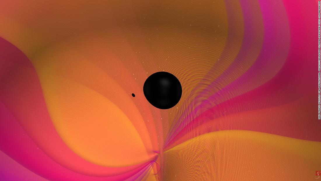 This image, taken from a video, shows what happens as two objects of different masses merge together and create gravitational waves.