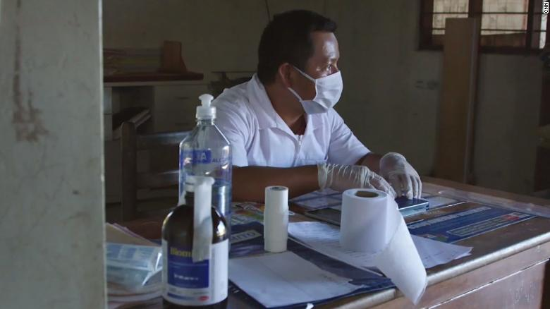 Elias Magin sits inside the clinic in Caimito.
