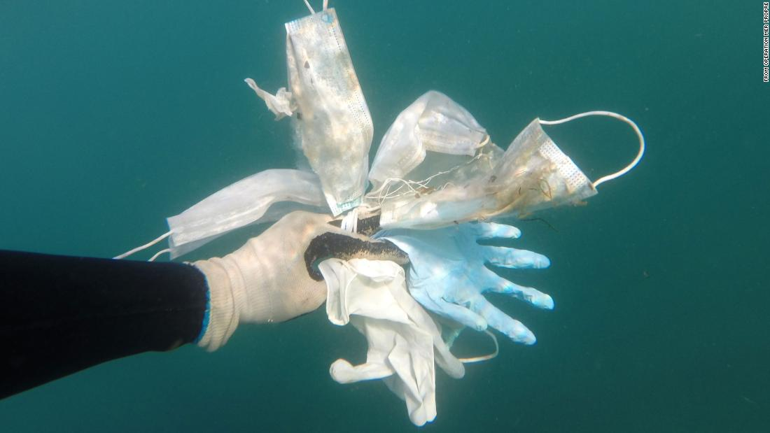 Used masks and gloves are collected from the ocean.