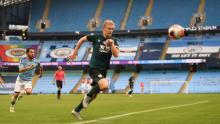 Ben Mee chases the ball during Burnley's 5-0 defeat by Manchester City.
