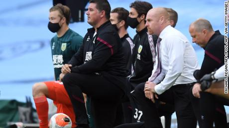 Burnley manager Sean Dyche (right) takes a knee in support of the Black Lives Matter movement.