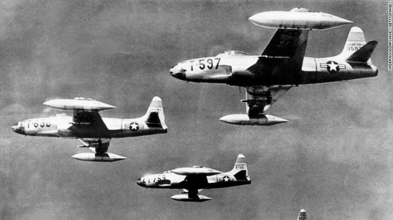 Four F-80 jet fighters flying at 30,000 feet on their flight from a Japanese base to their mission against the North Korean cCommunist army columns, Korea, July 13, 1950.