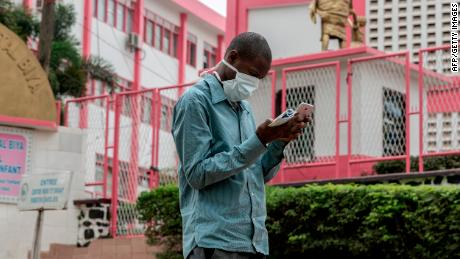 A man walks outside the entrance to the Yaounde General Hospital in Yaounde, Cameroon on March 6, 2020.