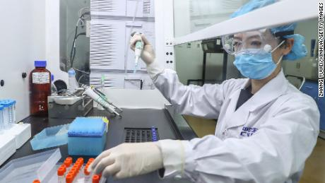 A staff member tests samples of the inactivated virus vaccine at a production plant of the China National Pharmaceutical Group in Beijing, on April 11.