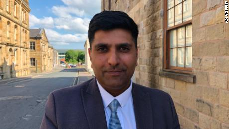 "Khan says that despite the Burnley's past, it has become a ""very cohesive community."""