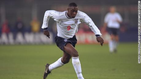 Heskey is pictured playing for England against Italy.