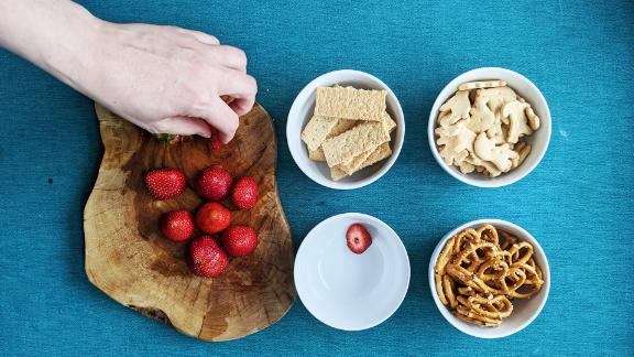 Graham crackers, animal crackers, strawberries and pretzel twists make great dippers for Funfetti dip.