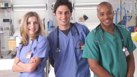 Actors Sarah Chalke, Zach Braff and Donald Faison pose for promotional photos on TV shows