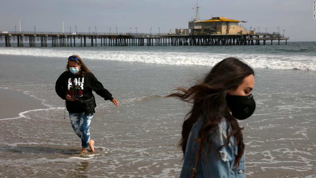 "Malia Pena and her mother, Lisa Torriente, wear masks as they visit the beach in Santa Monica, California, on June 23. California was among 25 states <a href=""https://www.cnn.com/2020/06/23/us/us-coronavirus-tuesday/index.html"" target=""_blank"">that had recorded higher rates of new cases</a> compared to the previous week."