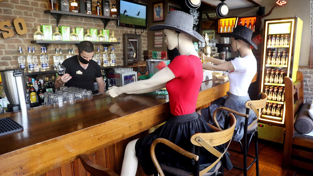 Mannequins sit at the Elpaso Bar in Ankara, Turkey, to make customers observe social distancing on June 24. The bar reopened after being closed for weeks.