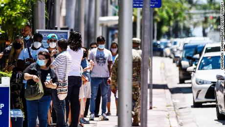 People wait in line to get tested for the coronavirus at a COVID-19 testing site in Miami Beach, Florida on Wednesday, June 24, 2020.
